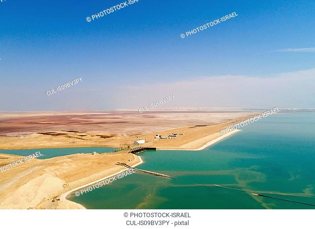 Canal leading water to Dead Sea Works by shore, Dead Sea, Israel. Aerial photography with drone