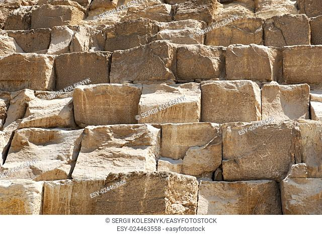 Brown stony wall of egyptian pyramid closeup