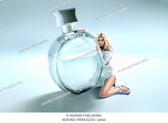 Conceptual picture of woman hugging the perfume