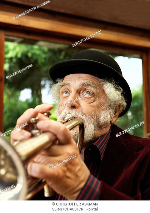 Older man playing trumpet