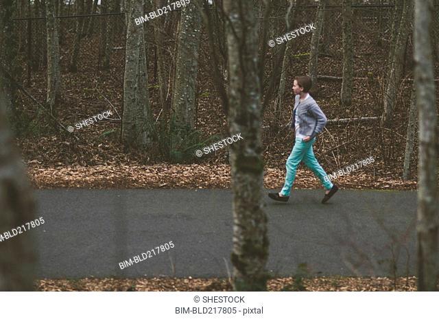 Girl walking on rural road