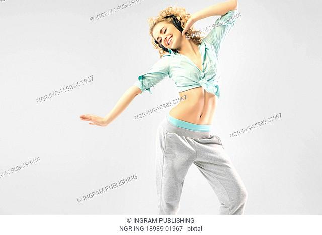 Blond alluring lady dancing alone