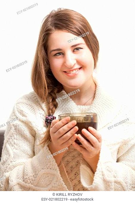 Portrait of beautiful brunette woman holding big cup of tea