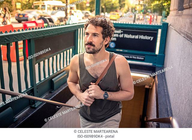 Man coming out of subway, Manhattan, New York, US