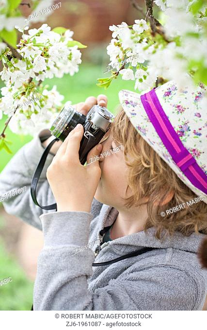 Boy photographing in the garden