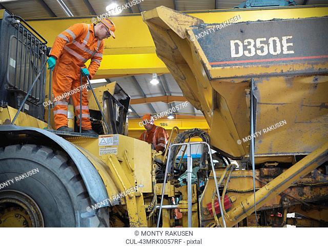 Engineer teaching apprentice on truck