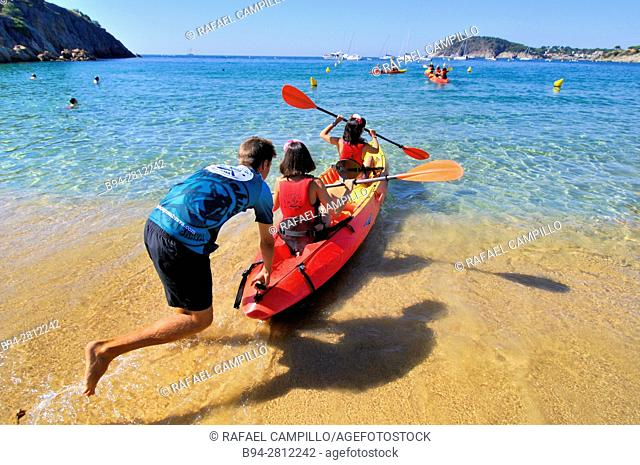 Kayak. Playa de Castell, Castle beach, Palamós town and municipality in the Mediterranean Costa Brava, located in the comarca of Baix Empordà