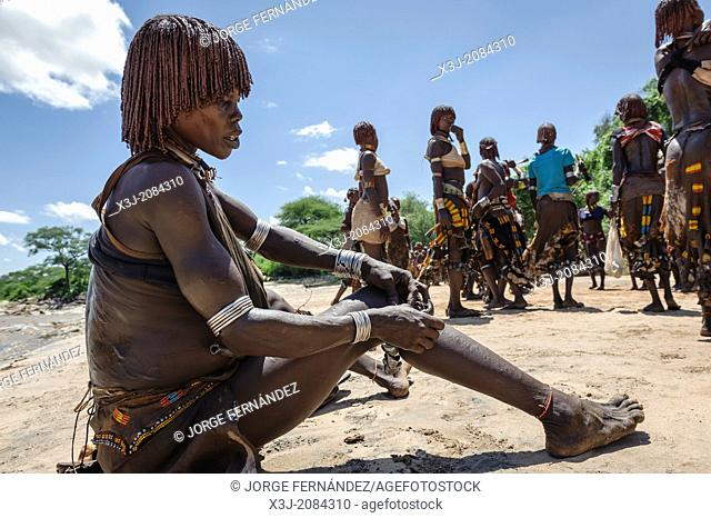 Women dancing during a bull jumping ceremony. A rite of passage from boys to men. Hamer tribe, Omo valley, Ethiopia