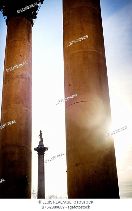 Nelson's Column seen through the columns of St. Martins ch, Trafalgar Square, London, England
