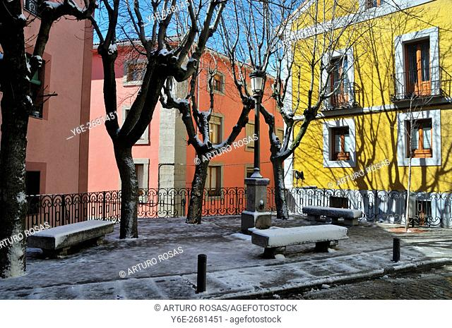 Little square in winter in the historic center of San Lorenzo de El Escorial (Madrid), Spain