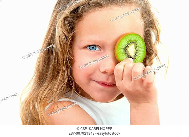 Close up of blond girl holding fruit