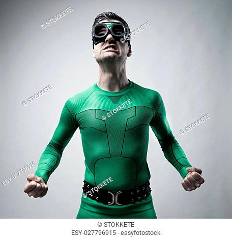 Funny green superhero snarling and ready to punch