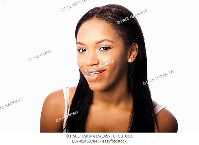 Beautiful happy smiling teenage girl with dental braces, on white