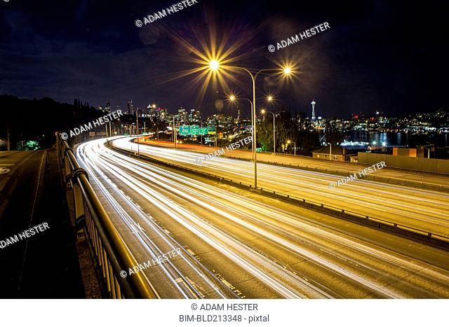 Long exposure of traffic on urban highway and city skyline at night, Seattle, Washington, United States