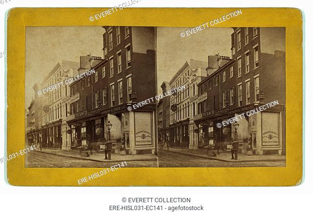 Philadelphia in 1870. Chestnut Street below 11th street on the South Side. Shops sell consumer goods and clothing. Pedestrians moving slowly are seen while only...