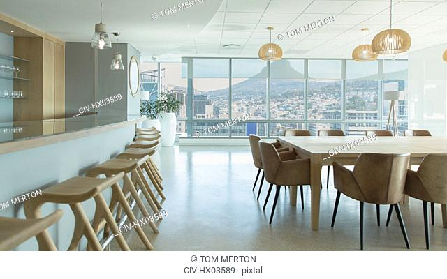 Barstools along counter in urban, modern conference room cafeteria
