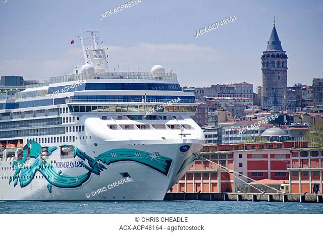 Cruise ships on the Golden Horn with Beyoglu district and Galata Tower beyond, Istanbul, Turkey