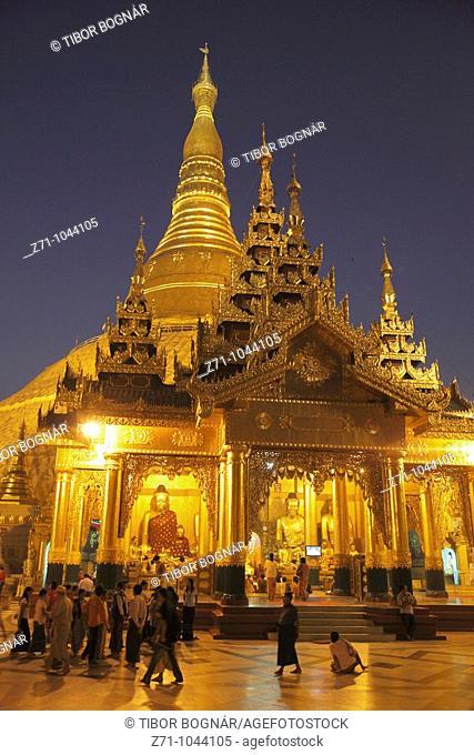 Myanmar, Burma, Yangon, Rangoon, Shwedagon Pagoda at night, people