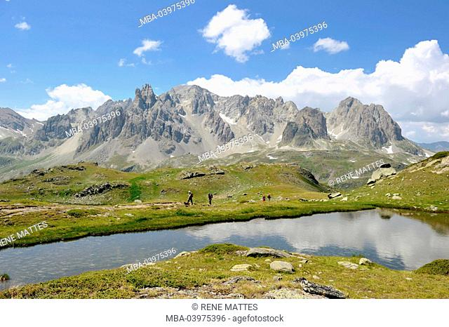 France, Hautes-Alpes, Brianconnais area, the upper valley of La Claree, hiker at Long lake (2387m)