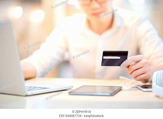 Man hand holding credit card, see the security code and using laptop computer for online shopping and online payment, modern lifestyle with digital transaction...