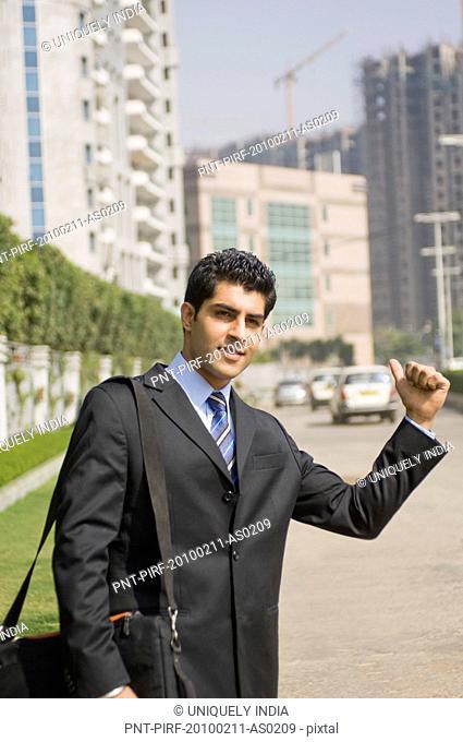 Businessman hitchhiking, Gurgaon, Haryana, India