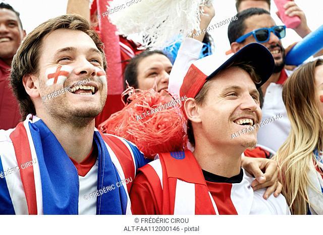 British football fans watching football match