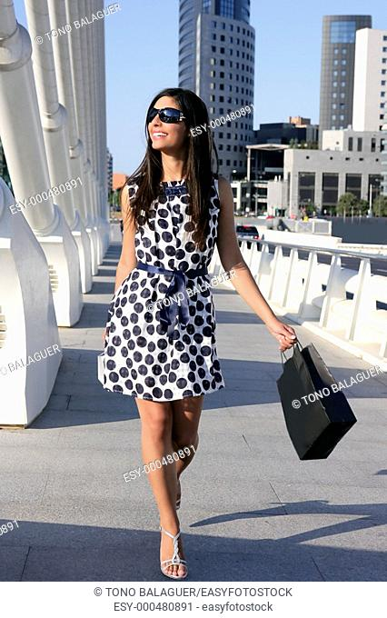 Beautiful brunette shopaholic outdoor modern city urban street