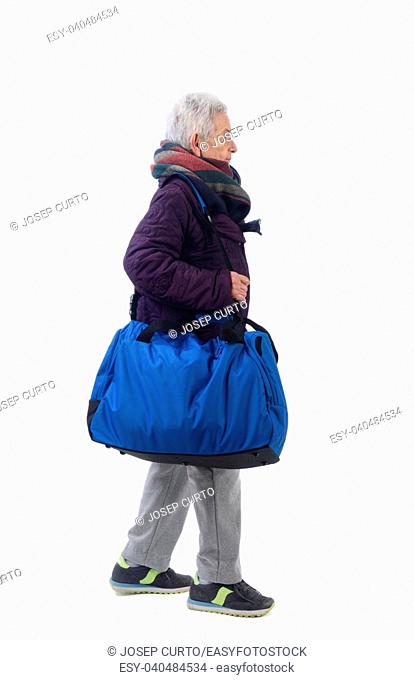 Senior woman walking to the gym with white background