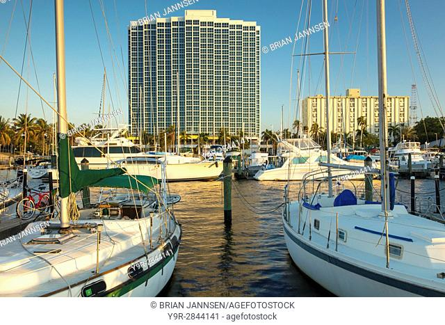 Boats moored in the Fort Myers Yacht Basin with condominium towers beyond, Ft Myers, Florida, USA
