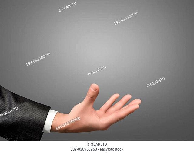 A hand of a businessman in a gray suit palm up. Closeup