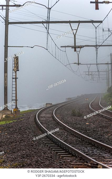 Overhead gantries support high voltage electric cables on a railway. Cape Town, South Africa