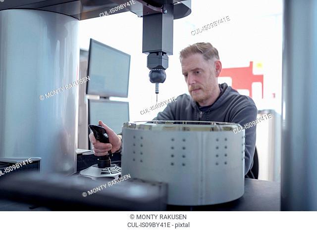 Engineer measuring parts in engineering factory