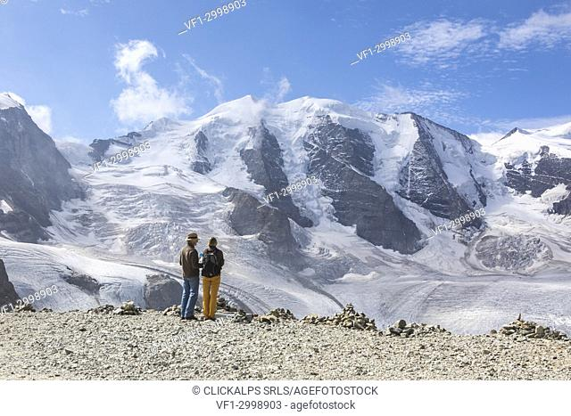 Tourists admire the Diavolezza and Pers glaciers and Piz Palù covered with snow, Engadine, canton of Graubünden, Switzerland