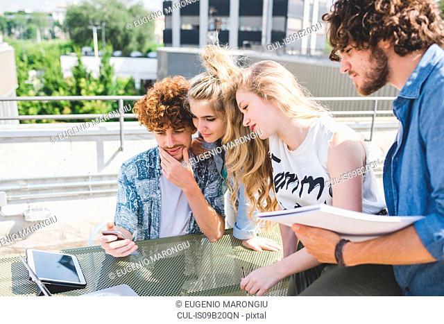 Friends on social media outdoors