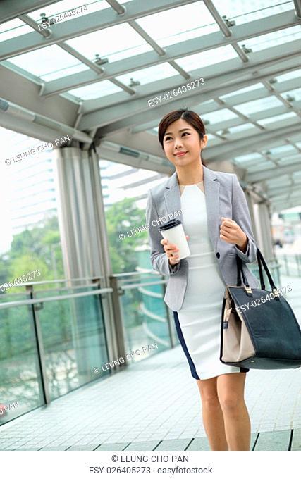 Businesswoman walking at street