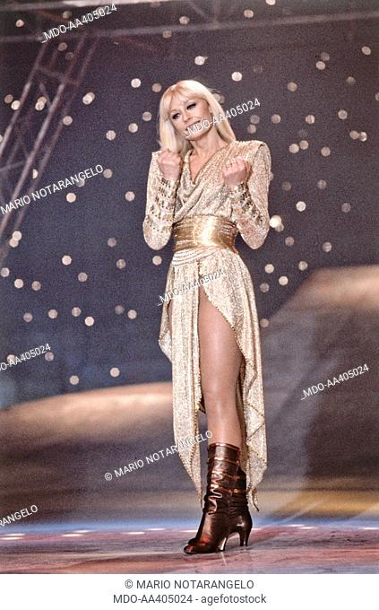 Raffaella Carrà wearing a golden dress in Buonasera Raffaella. Italian TV presenter, actress, singer and showgirl Raffaella Carrà (Raffaella Maria Roberta...