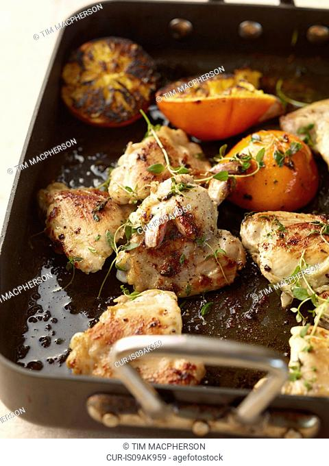 Rustic roasted garlic chicken with orange and thyme
