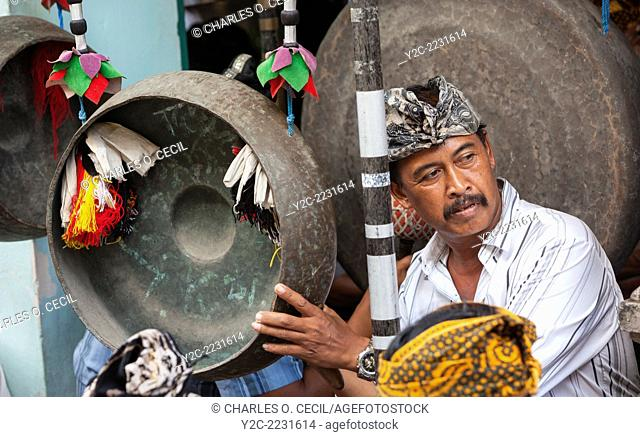 Bali, Indonesia. Balinese Hindu Playing a Gong in a Village Gamelan Orchestra