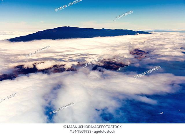 Haleakala or the East Maui Volcano, elevation of 10,023 ft 3,055 m, standing above massive clouds, Maui, Hawaii, USA