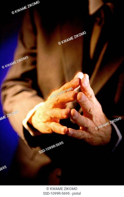 Close-up of a businessman with his hands together