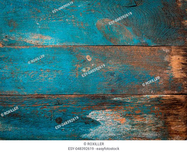 old wooden texture with a shabby blue paint front