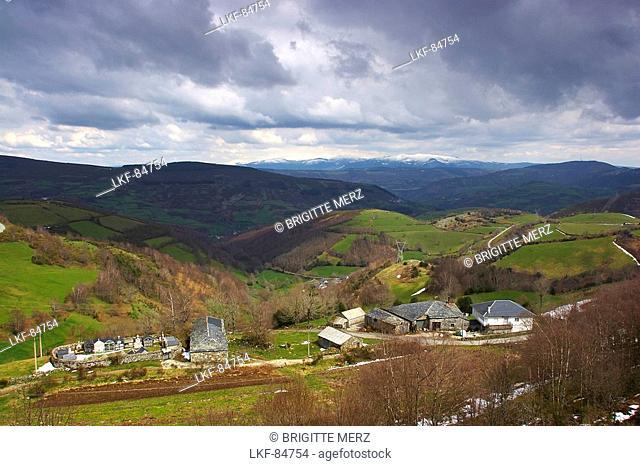 Landscape with church and farm, mountains in the distance, Cordillera Cantabrica, Punto el Poyo, Galicia, Spain