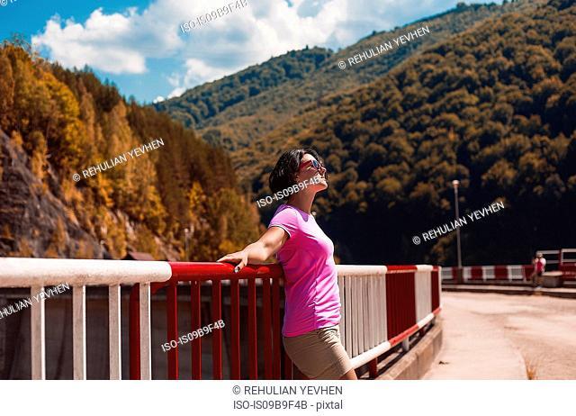 Woman leaning against safety barrier, Koralat, Zagrebacka, Croatia
