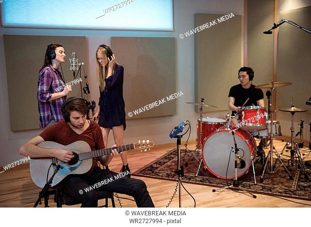 Music band performing in studio