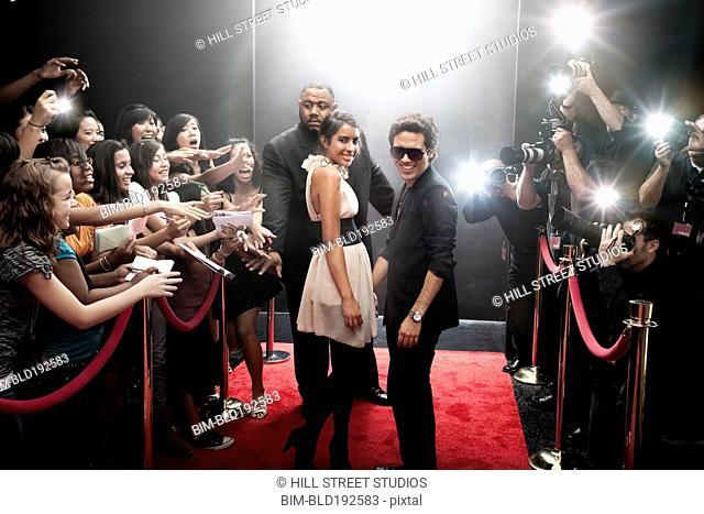 Celebrities arriving on red carpet