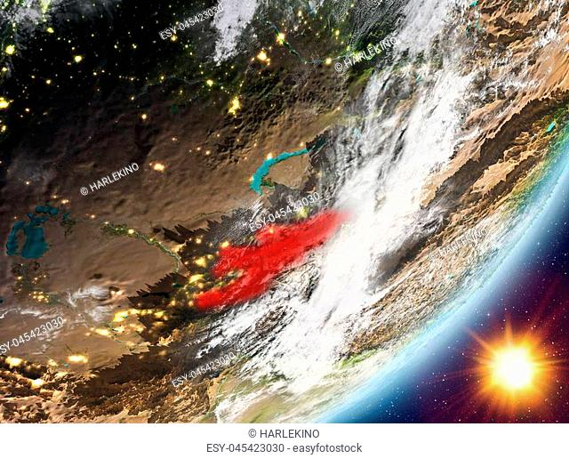 Kyrgyzstan from orbit of planet Earth in sunrise with highly detailed surface textures and clouds. 3D illustration. Elements of this image furnished by NASA
