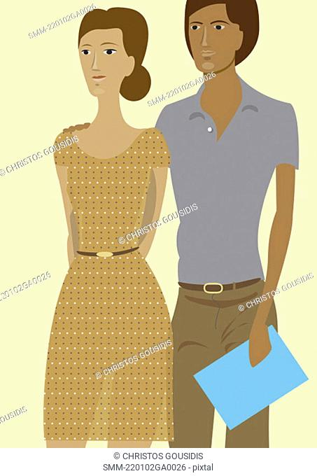 Ordinary looking couple with a paper in hand