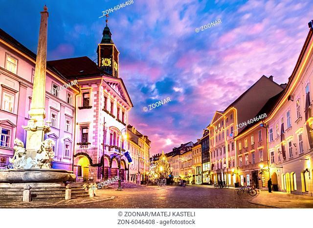 Romantic Ljubljana's city center, the capital of Slovenia, Europe. City hall and Roba's fountain shot at dusk