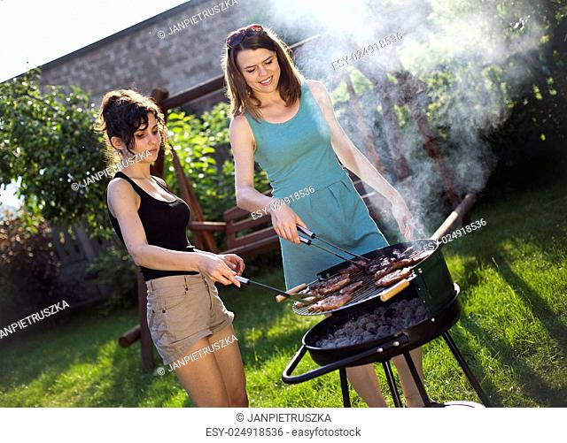 Two girls on grill, natural colorful tone