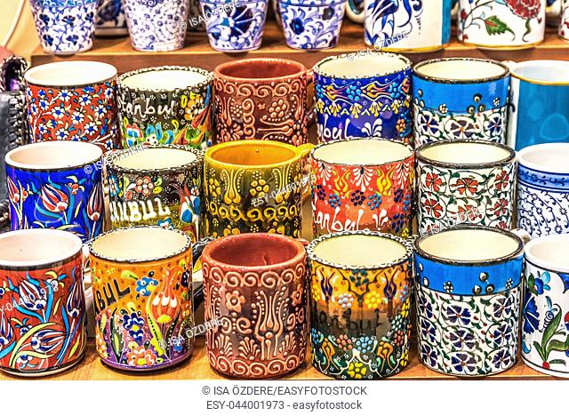Collection of Traditional Turkish ceramic cups with painted landmarks on sale at Grand Bazaar in Istanbul, Turkey. Colorful ceramic souvenirs